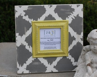 4x4 jagged diamond design lightly distressed frame in dark grey mystique white inner trim is mustard yellow