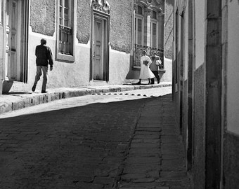 People walking  on a Guanajuato street  in 1995- a black and white photograph