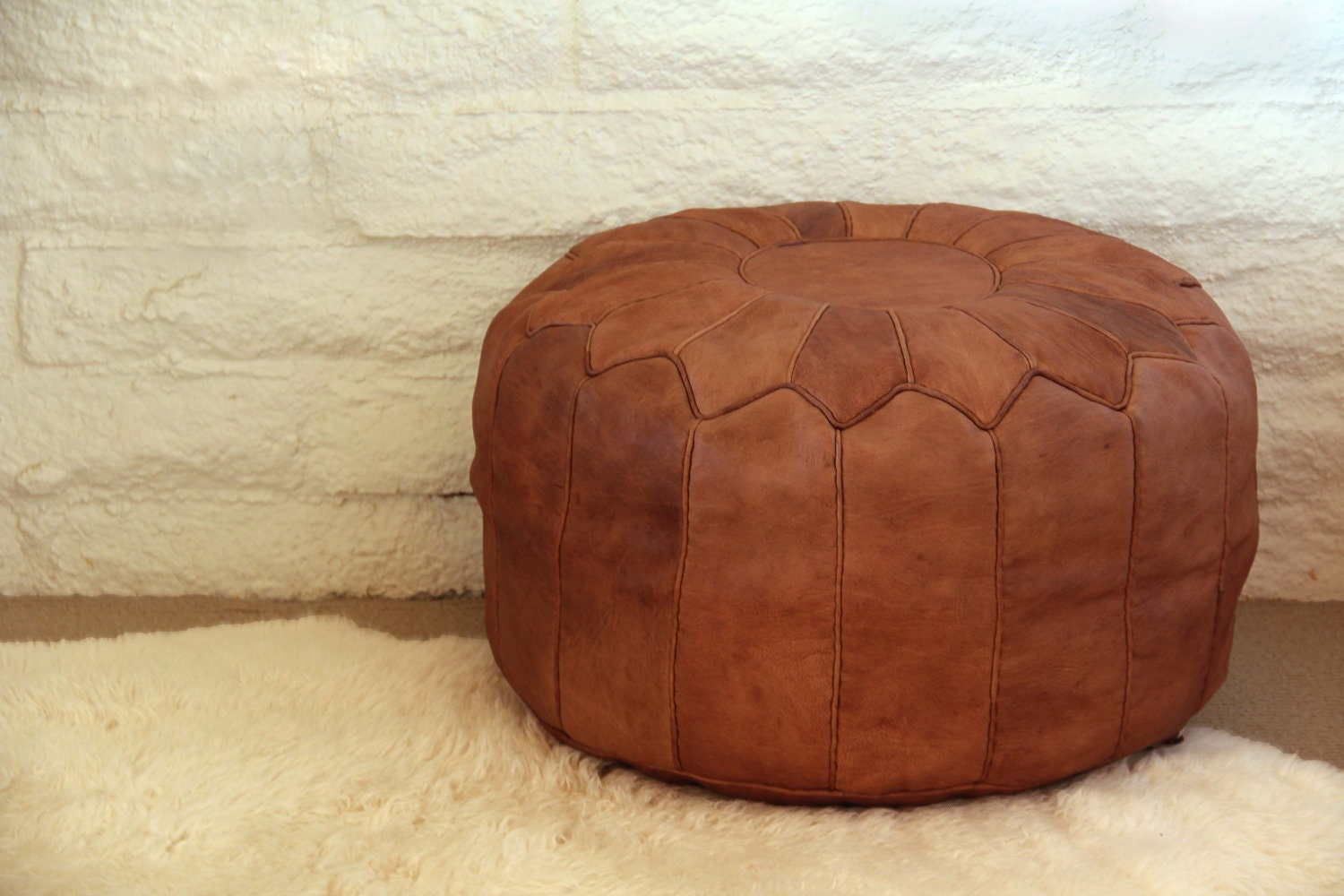 tan moroccan leather pouf discounted for irregular leather. Black Bedroom Furniture Sets. Home Design Ideas
