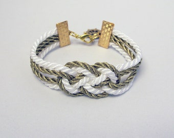 White and metallic gold double infinity knot nautical rope bracelet with gold ship wheel charm