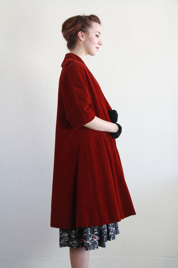 Our women's swing coat is a fashionable update on a classic style. Details Gorgeously designed with a flattering, face-framing portrait collar, empire waist, and swingy shape, this plush wool-blend swing coat is a fashionable update to a vintage style.