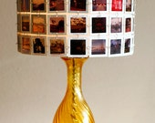 Lampshade made from vintage slides with amber glass base.