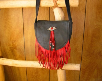"Southwestern Black and Red deerskin leather purse with fringe, metal concho, red and black beads, 7"" x 6"" x 2.25"", 1"" x 20"" flat strap"