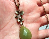 A Drop of Jade - Jade Teardrop with Cascading Orchids Pendant in Antique Brass