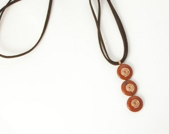 Kinetic caterpillar three levels brick red jasper gemstone casual pendant with copper spirals made in Israel
