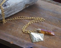 The Shield and The Sword . Golden Brass and Quartz Crystal necklace
