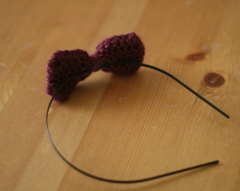 Knit bow on metal headband in burgundy