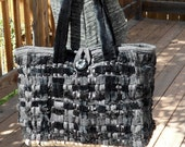 Black woven handbag of ribbons of wool, faux fur, and satin with vintage button