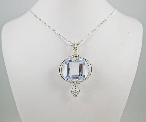 Aquamarine and argentium silver wire pendant