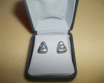 Smooth Silver Triangle Earrings With Blue Stones