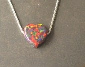 orange/red  iridescence heart, opal like small heart necklace, pink synthetic resin heart strung on a sterling silver necklace,