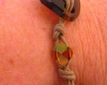 Swarovski brown twist crystal with gold on brown waxed cotton cord