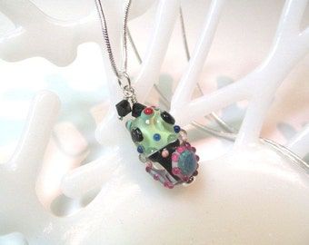 Necklace black green pink glass art lampwork bead with black crystals