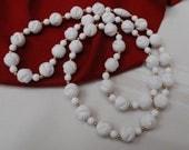 white knott design bead necklace
