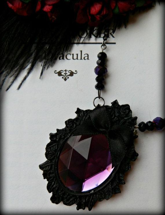 Purple and black rose cameo necklace.
