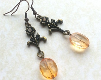 Amber Flower earring - Upcycled brass flower with pink sparkly 'gem' and faux amber bead