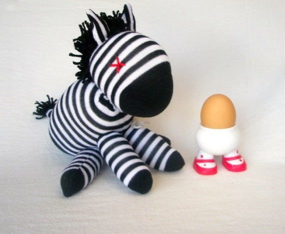 Sock animal, sock zebra, sock monkey, soft plush toy for children. Black and white.