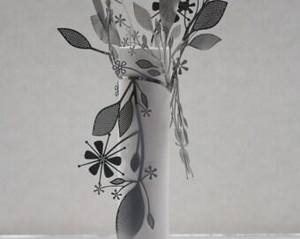 Porcelain vase with metal. Metal foliage wrapped around a stoneware Parian porcelain tall tube.