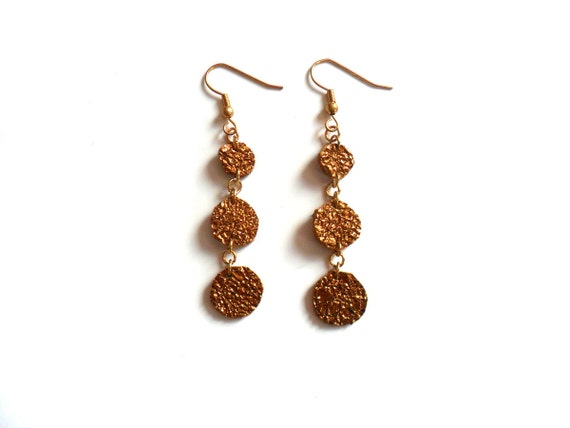 Metallic bronze bubbles leather earrings