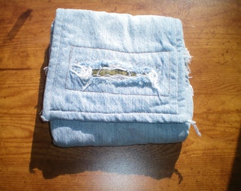 ripped denim padded pouch