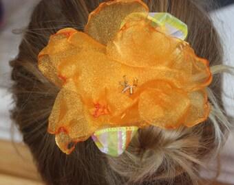Gorgeous orange organza flower on an alligator clip