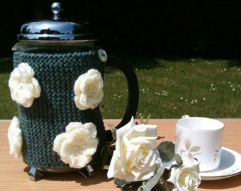 Hand knitted wild rose Cafetiere hug