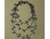 Jaded bicycle inner tube necklace