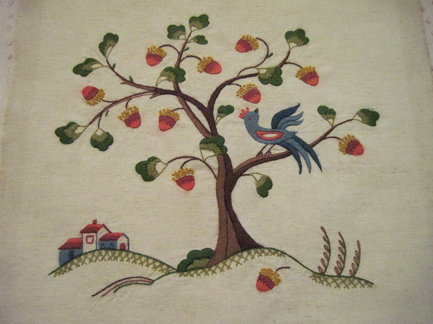 Vintage crewel embroidered blue bird in a acorn tree