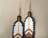 Mario Feather Earrings -  handmade, feather, nintendo, geekery, funky