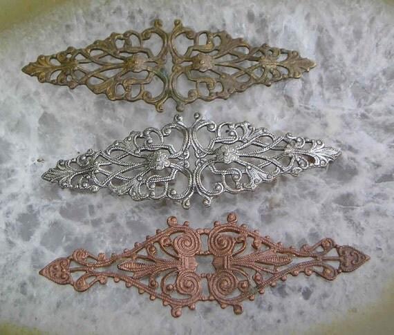 Three vintage brass ring making filigrees..