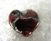 Heart of glass: transparent red with fine silver foil, lampwork heart pendant/ornament by Christine Hansen