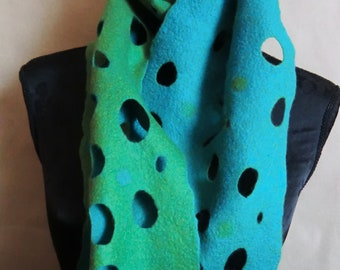 Hand felted long scarf with a lot of holes but still warm.