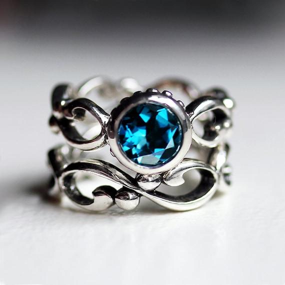 blue topaz engagement ring set bezel engagement ring