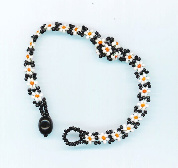 Friendship Bracelet . Beadwoven Floral . Black & White Beaded Bracelet . Daisy Daisies . OOAK - Field of Flowers by enchantedbeads on Etsy