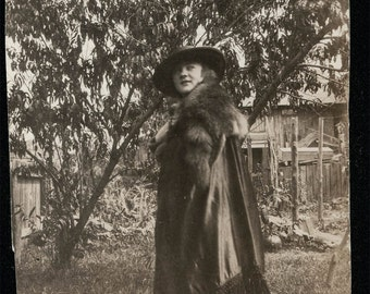 vintage photo Young Lady poses in her new Fur Stole COat garden