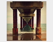Under the Pier: square fine art photography print of Outer Banks, North Carolina Beach in brown an aqua