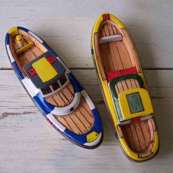 Two Yellow and Blue Toy Wooden Boats
