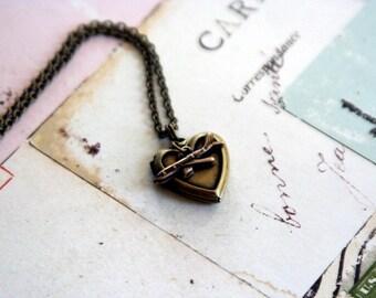 tiny airplane. locket necklace. in brass ox