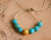Chunky aqua blue and golden yellow beaded string bracelet. Tiedupmemories