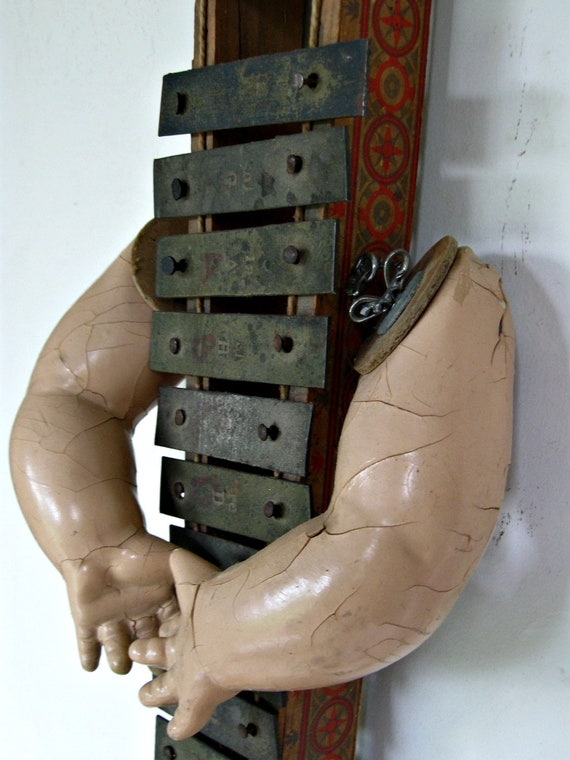Art Assemblage - antique xylophone and doll parts