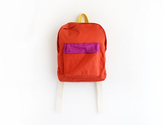 orange backpack with magenta pouch