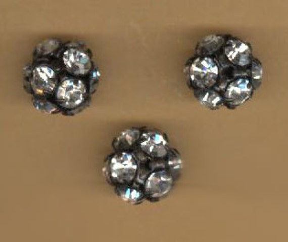 vintage swarovski crystal 10mm beadballs clear and black oxidized core, three pieces, sparkling as can be, great patina