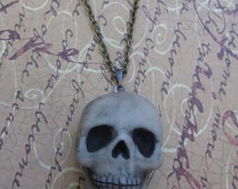 Grim skull locket