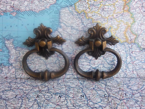 2 large metal pull handles with ornate attached backplates includes hardware