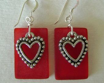 Sea glass dangle earrings with a heart charm