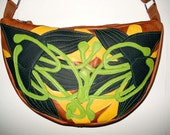 Handmade Crescent Bag in tan leather with perforated forest green appliqued Lilies