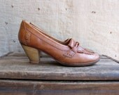 vintage 1970s fringed leather moccasins with stacked wood heels sz 7 75