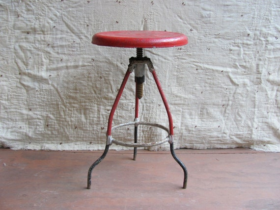 vintage c. 1930s red industrial shop stool with revolving adjustable seat