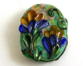 One Sided Orange and Blue Floral Arrangement Oval Lampwork Glass Bead by GlassElephant