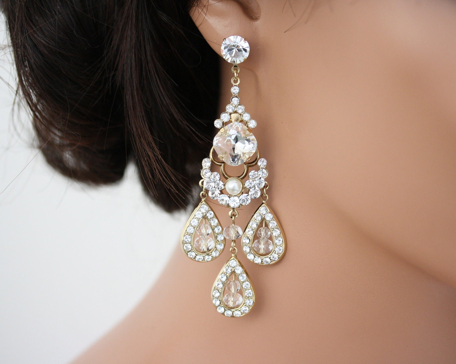 Everyone is giving these gaudy earring trends a go this year chandelier earrings arubaitofo Gallery